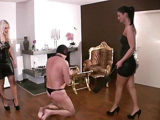 Sadistic bitches stroke their slave!