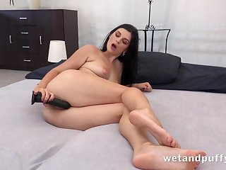 Cutie gapes her cunt with a toy added to masturbates