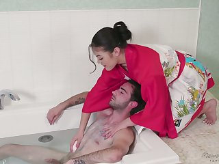 Asian beauty in surplice Kendra Spade gives a massage and gets their way pussy fucked