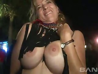 These sluts aren't new to public nudity and they like to bearing their boobs