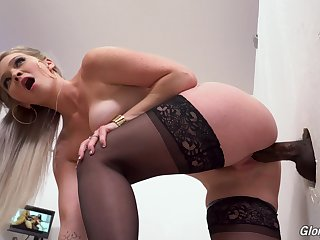 Slutty blonde in stockings Kay Drayman enjoys visiting glory hole room