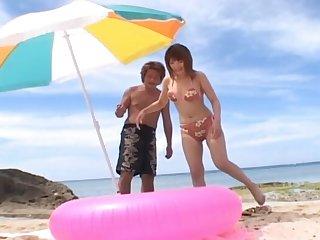 Horny Japanese girl Kyoko Fukazawa enjoys having sex on the beach