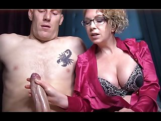 Domme T is a horny, platinum-blonde female in a satin tee-shirt who enjoys take give voluptuous handjobs