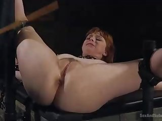 Nasty, crimson haired woman is getting strapped up and humped stiff, while bellowing outlander elation